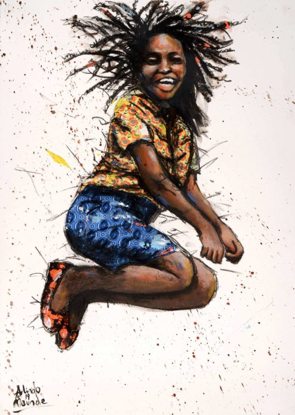 Young African woman jumping in excitment and joy