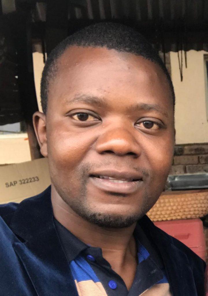 Petros Mwenga smiling